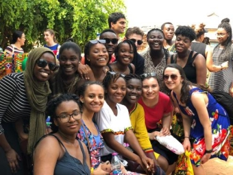 Students posing in a group while on a trip in Ghana