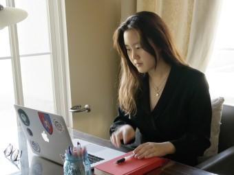 Angelina sitting at computer