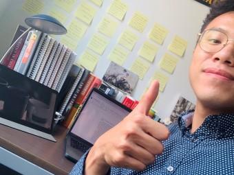 Xiteng posing at work desk