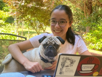 Intern in her office space with her dog.