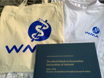 A bag, a t-shirt, and a book given as internship gifts