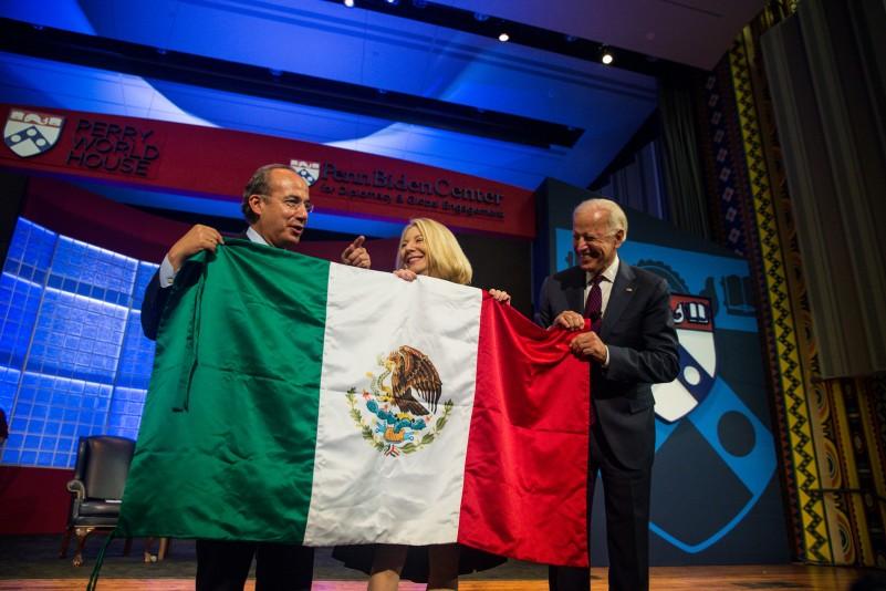 President Calderon, Penn President Gutmann and Joe Biden hold up the Mexican flag