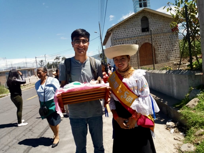 Jeffrey in a procession with a member of his host family in Ecuador