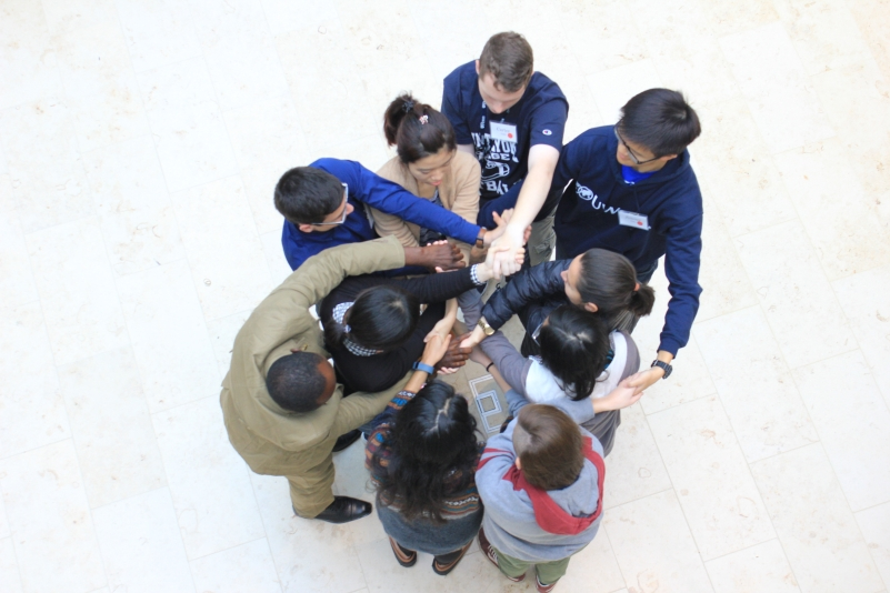 A group of people participating in an intercultural activity