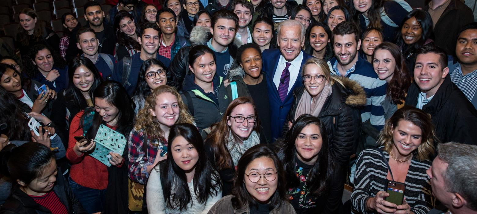 Joe Biden takes a photo with Penn students after a speaking event.