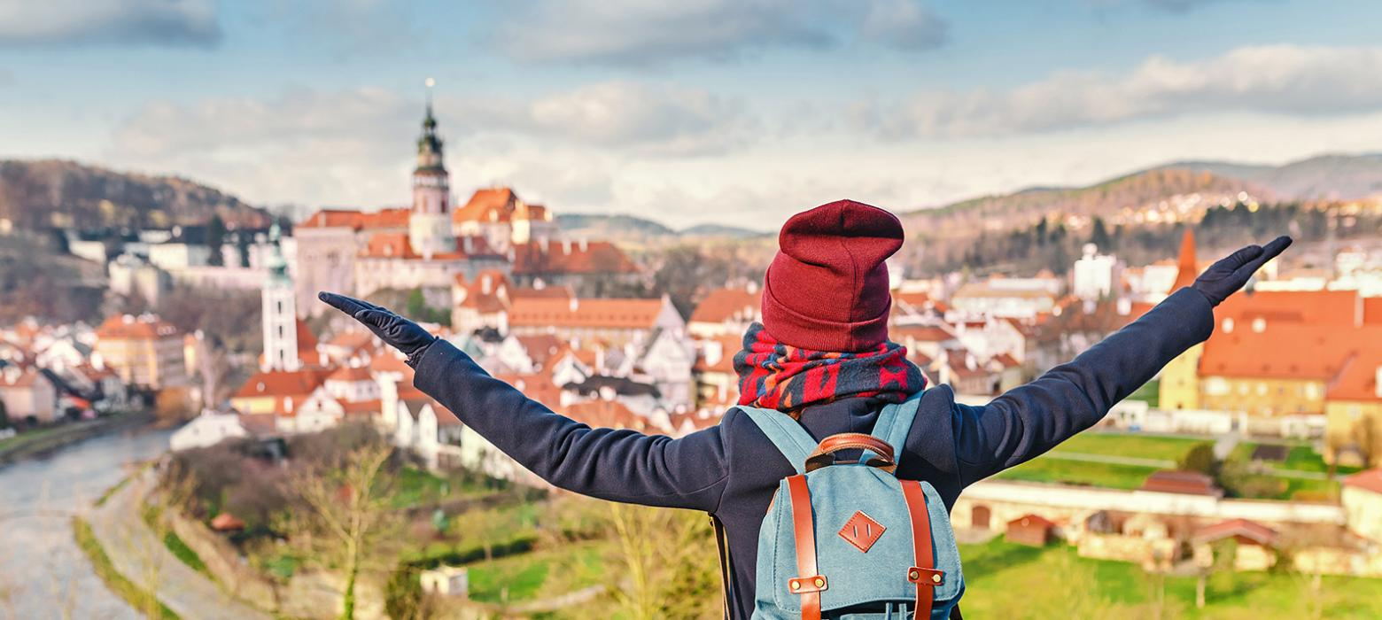 Student stands over a hill in the Czech Republic