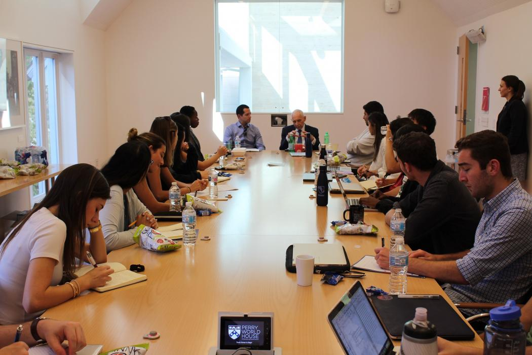 Ambassador William Lacy Swing talks with Perry World House Student Fellows about migration